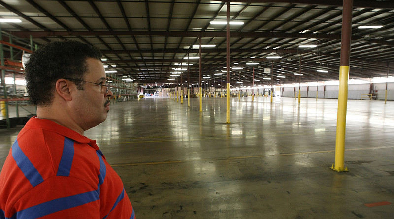 Chuck Evans, Plant Manager at Blitz U.S.A., looks over a warehouse that once was filled with gasoline cans company produced.  The Miami Oklahoma based company laying off over 100 employees.