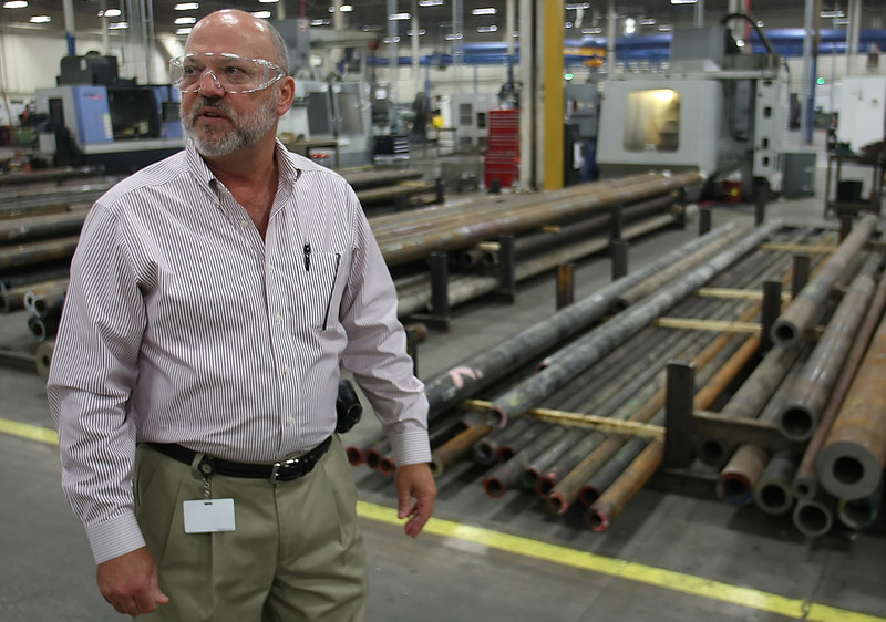 Dale Fain, President & CEO of Team Oil Tools, walks through the companies manufacturing plant in Tulsa.