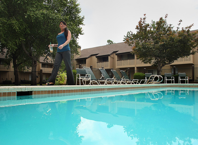 Heather Sutherland inspects the pool at the Pheasant Run Apartments in Tulsa.