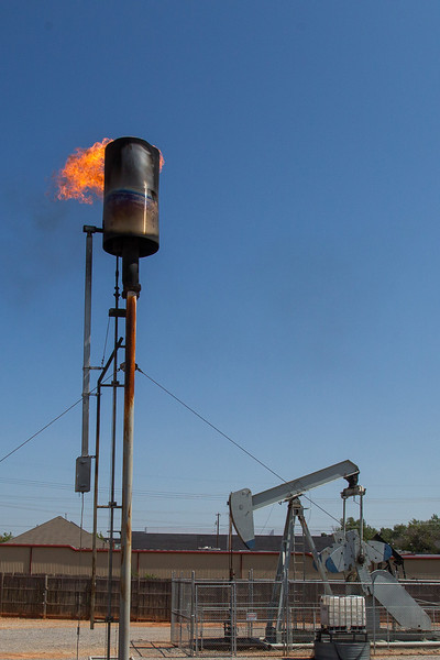 Execess gas is burned off at a pump-jack site on north Classen across from the Belle Isle shopping center.