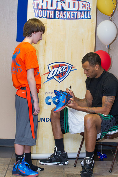 Oklahoma City Thunder's Daequan Cook paid a visit to the Thunder Youth Basketball camp being held in Edmond. Cook answered questions, lead drills and signed autographs for each kid in attendance.