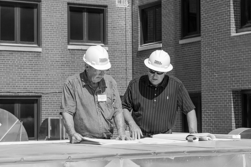 On the roof of the exsisting radiation oncology center site superintendent Ted Boatman and project manager Patrick Ruby go over plans for the next phase of construction at the VA Hospital on NE 13th. Three floors are being added on top of the ground floor radition center.