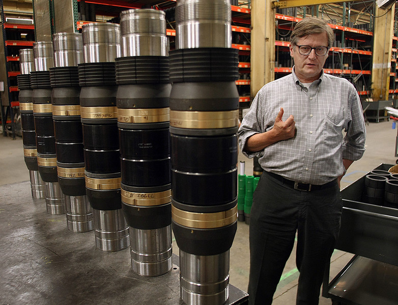 Lee Eslicker, CEO of D&L Manufacturing stands next to oil tools his company manufactures in Tulsa.
