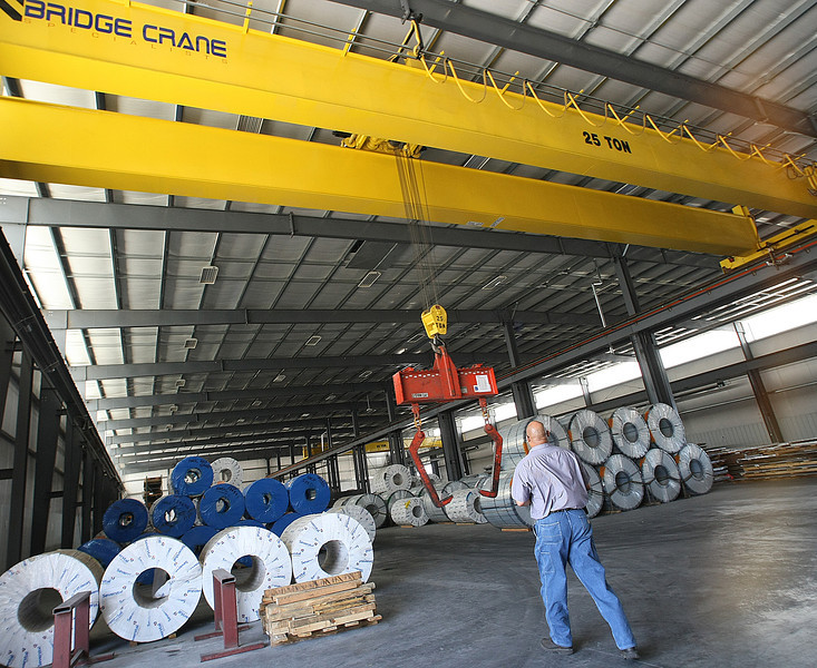 Tim Clark, Warehouse Manager for Catoosa based MetalWest, operates a 25 ton capacity bridge crane to load customers orders for shipping.
