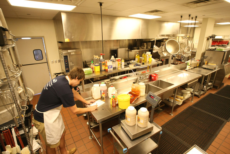 A Volunteer works in the kitchen at the Community Food Bank of Eastern Oklahoma.