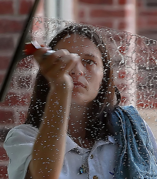 Stephanie Anderson cleans windows at the Spirit Center in Bixby.