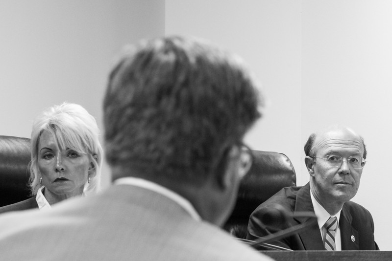 Corperation Commision Chair Dana Murphy and commisioner Bob Anthony listen to testimony from and OG&E witness during a hearing Monday morning. The hearing is in response to OG&S's proposed rate changes.