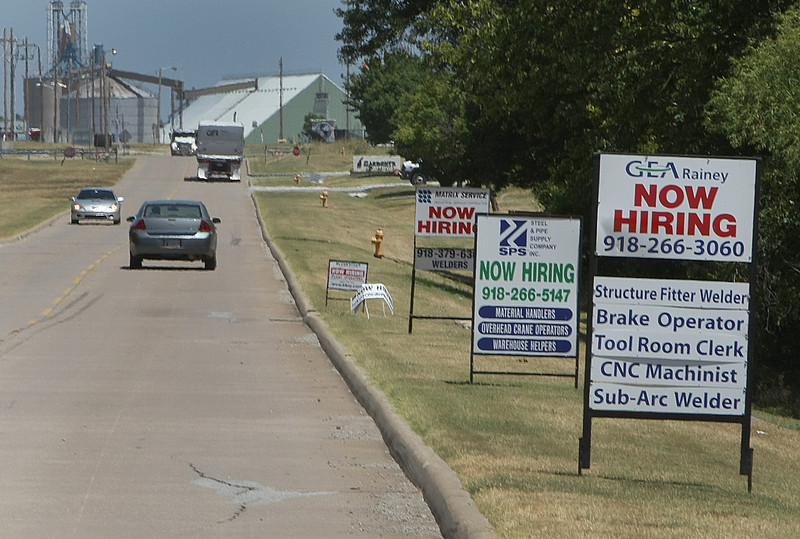 Signs line the road into the Port of Catoosa announcing positions available.
