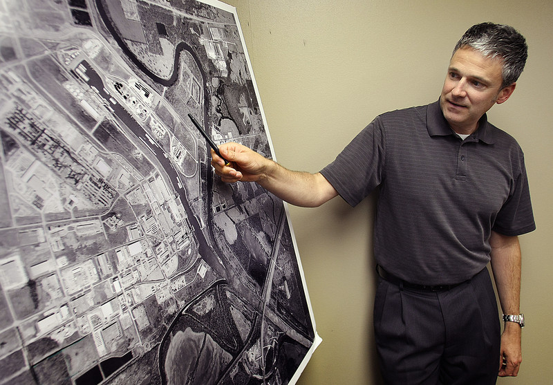 David Yarbrough, Deputy Director and Manager of Operations at the Port of Catoosa points to an aerial map while describing scheduled infrastructure improvements.