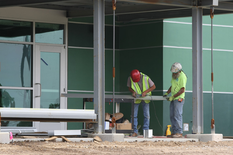 Workmen install windows at the North Regional Health and Wellness Center.  The center is Scheduled to open in August.