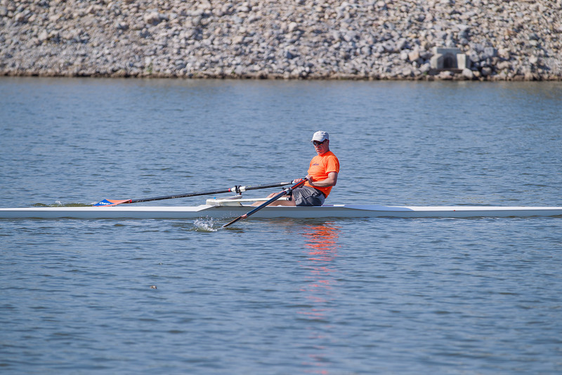 A rower heads west on the Oklahoma River near the Lincoln Street bridge.