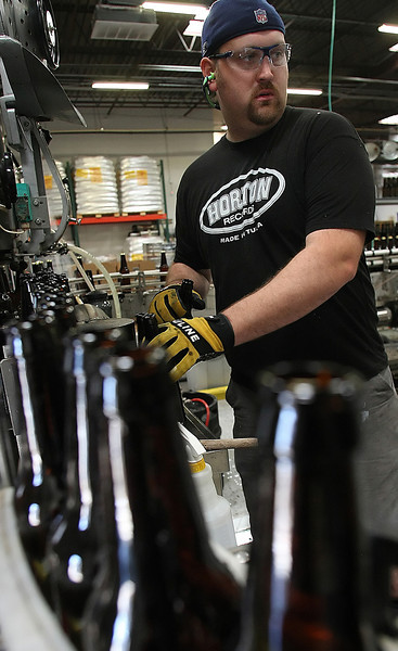 Eric Marshall, Owner of Marshall Brewing Company, bottles beer at the companies brewery in Tulsa.