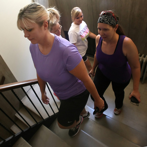 Brenda Conley, legal secretary at Hall Estill law firm, and her workout partners climb stairs at the 320 S Boston Building in Tulsa as their lunchtime workout.