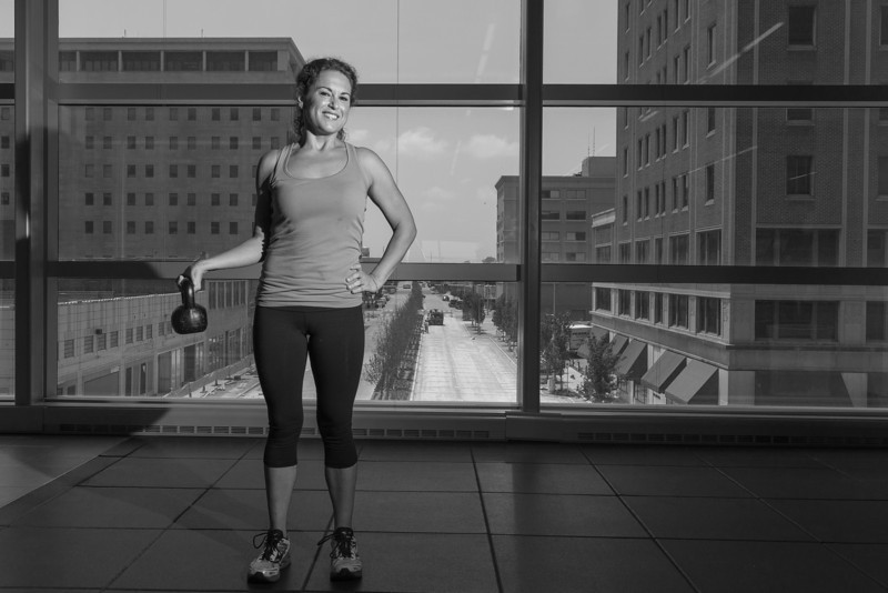 As an employee of Devon, Caterine Pryor has access to thier new private gym overlooking Main Street.
