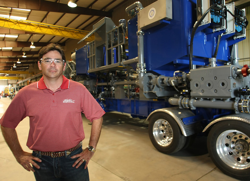 Brett Taylor, President of Taylor Industries, pauses for a photo in front of the companies new cement pumper under construction at the companies North Tulsa Manufacturing facility.