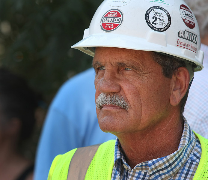 Kenny Lawson, a Project Manager for Flintco, watches the topping off ceremony of the Hardesty Arts Center in the Brady Arts District near downtown Tulsa.