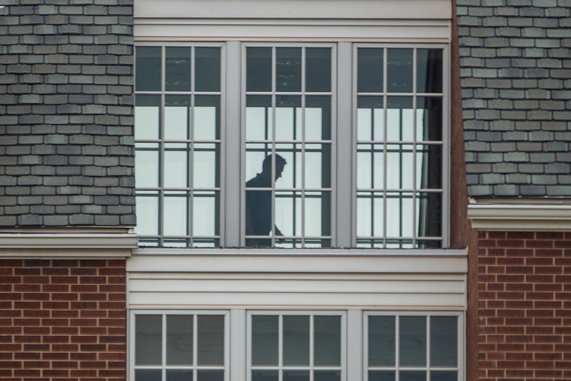 An man walks through the top floor of Building 11 on the Chesapeak campus.