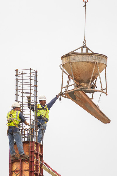Workers prepare to pour concrete to form a pylon for a new building located on the east side of the Chesapeak campus.