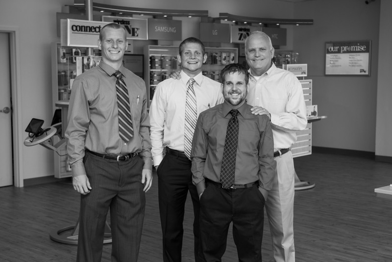 Working with his three sons, Tracy Holland opened a Wireless Zone franchise on Santa Fe and Edmond Road in Edmond. Photographed from left to right it Tucker, Chad, Eric and Tracy Holland.