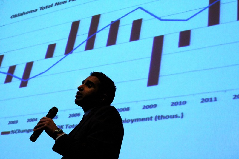 Mouhcine Guettabi, research economist with the Center for Applied Economic Research at Oklahoma State University's Spears School of Business, gives his presentation at the 2012 Owasso Economic Summit Friday.