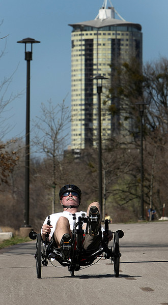 A cyclist takes advantage of the 80 degree weather  for a ride along the Arkansas River in Tulsa.