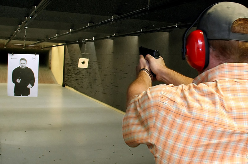 Cole Spencer fires a round at a silhouette target before at the C2 Shooting Center in Tulsa.