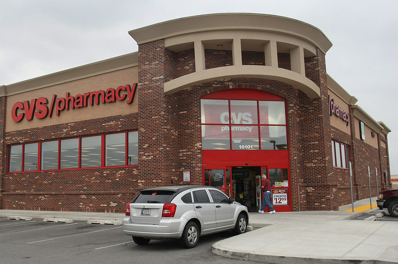 A customer enters a CVS Pharmacy in Tulsa.