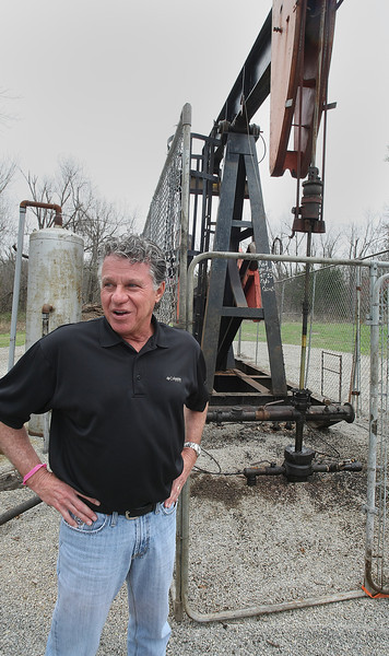 Steve Crowder, President of Little River Energy Company, stands next to the Wheeler No. 1 well in Drumright.  The well was drilled 100 years ago and produced continuously for 100 years.