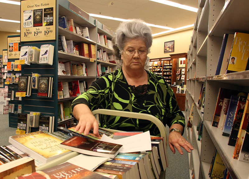 Tommye Lewis stocks the shelves at the Mardells book store.