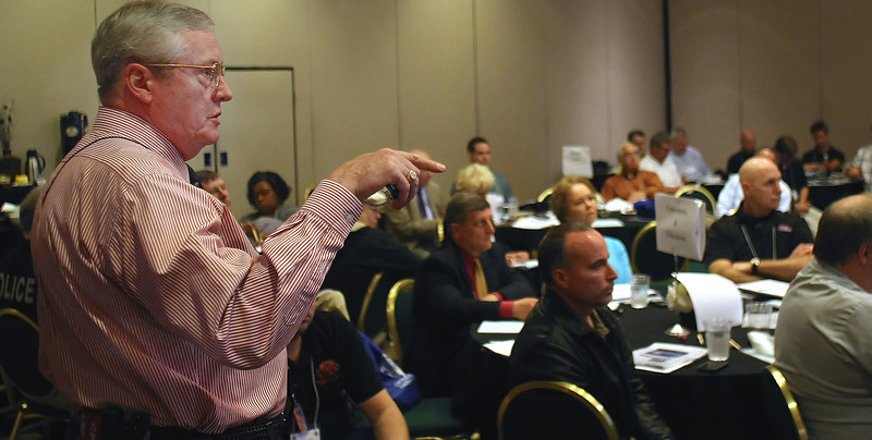 Douglas Kinney, Consultant for BDA Global, moderates a disaster preparedness tabletop exercise in Tulsa.  Tabletop exercises are used to help state and local government be prepared for and learn lessons from simulated major disruptions in electric, gas, water, and telecommunications services.