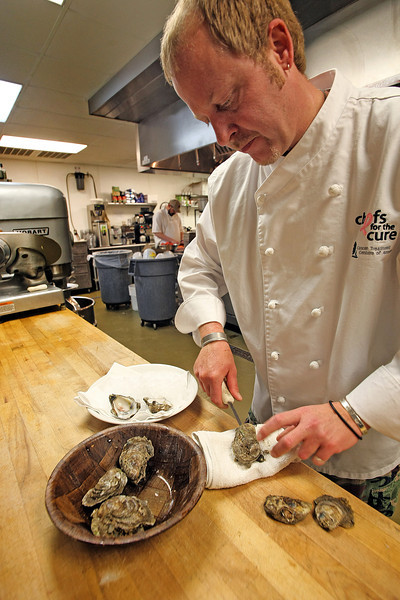 Executive Chef Tim Richards prepares Gulf Oysters.