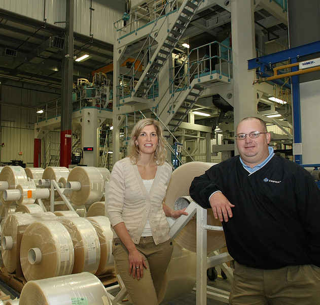 Rebecca Caser, Marketing Manager and Rusty Bright, Plant Manager of ExoPack pause for a photo at the companies Catoosa plastics manufacturing plant.