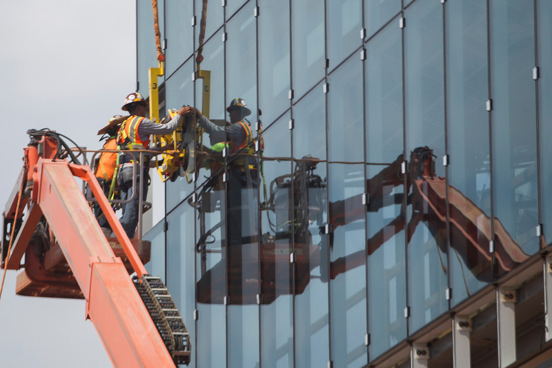 Works install glass on a new building located on the South East corner of Chesapeak Campus.