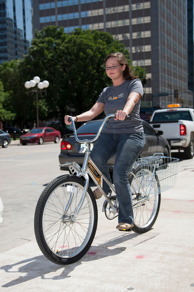 Gentry McKeown with Downtown OKC rides a Spokies bicycle during a demonstration of how riders will check the bikes out.