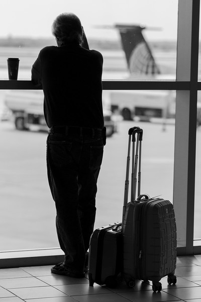 A man waits for his flight at Will Rodgers International Aitport.