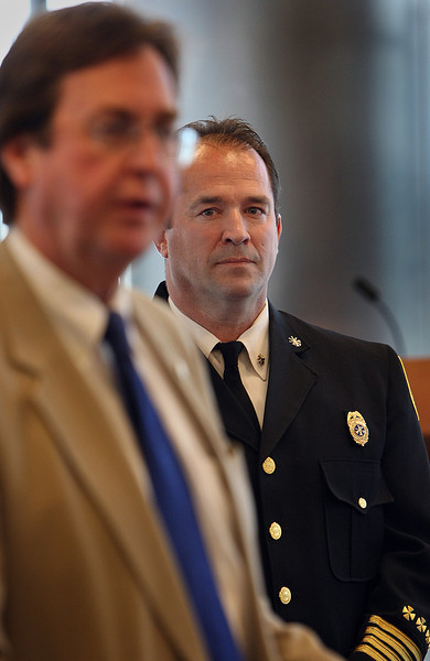 Ray Driskell listens to Tulsa Mayor Dewy Bartlett as he is introduced as the new Fire Chief.