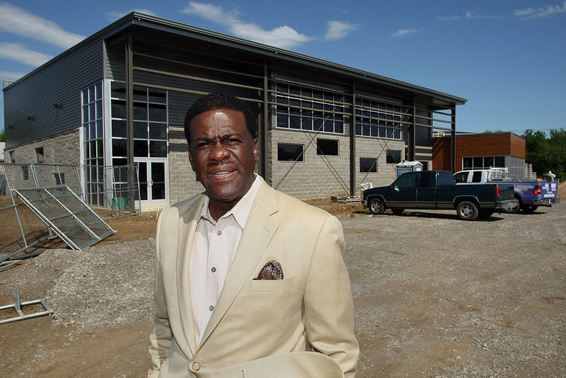 Reverend Willard L. Jones pauses for a photo in front of he Greater Cornerstone Community Development Project in West Tulsa.