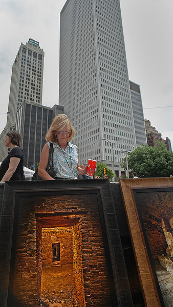 Donna Patterson looks through photographs at Tulsa's downtown Mayfest Art Show.