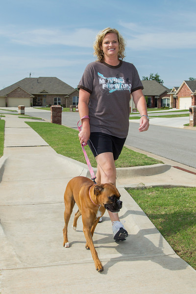 Staying active when ever she can, Ashlie Syder walks her dog.