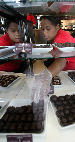 Sabrina Jones gathers chocolates for a mothers day gift at the Russell Stover Candy store in South Tulsa.