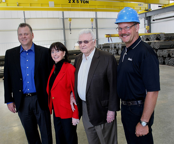 Mike Howard, Chief financial Officer, Dana Weber, President and Chief Executive, Bill Weber, Founder and Chairman and <br /> Gary Donegan, Project Manager for the Star Center pause for a photo at the companies new facility in West Sand Springs.