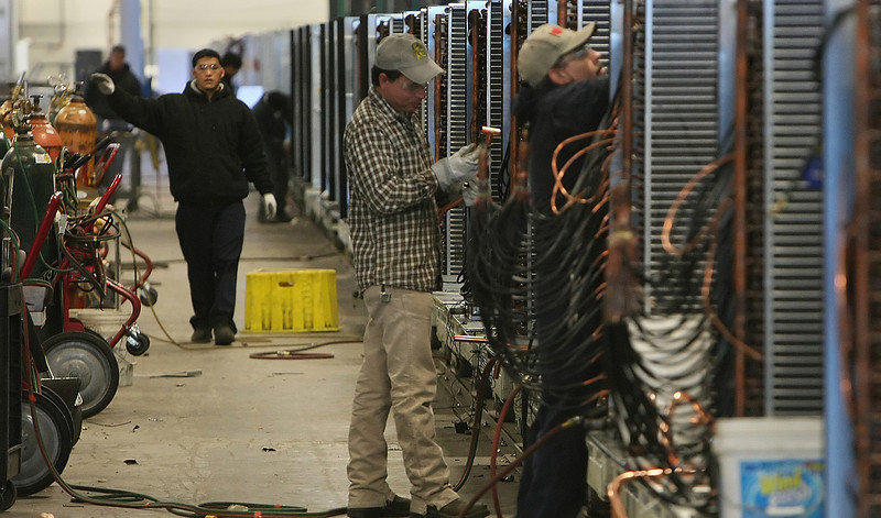 Workers at AAON assemble industrial Air Conditing Units at the companies Tulsa plant.
