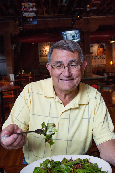 Gene Neuwman enjoys a salad at the Bricktown Brewery.