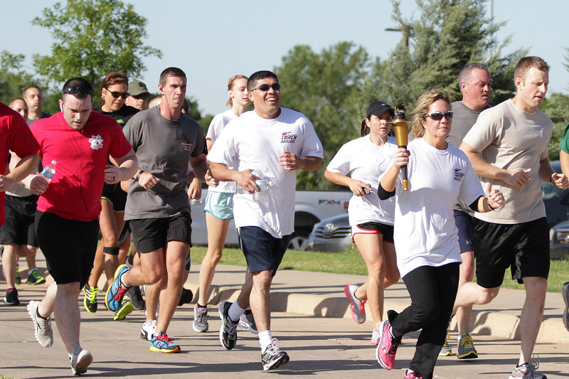 Repersenting the Oklahoma City Police, Oklahoma Highway Patrol, Army, Airforce  as well as others ran in the annual Tourch Run endind at the North steps at the State Capitol.