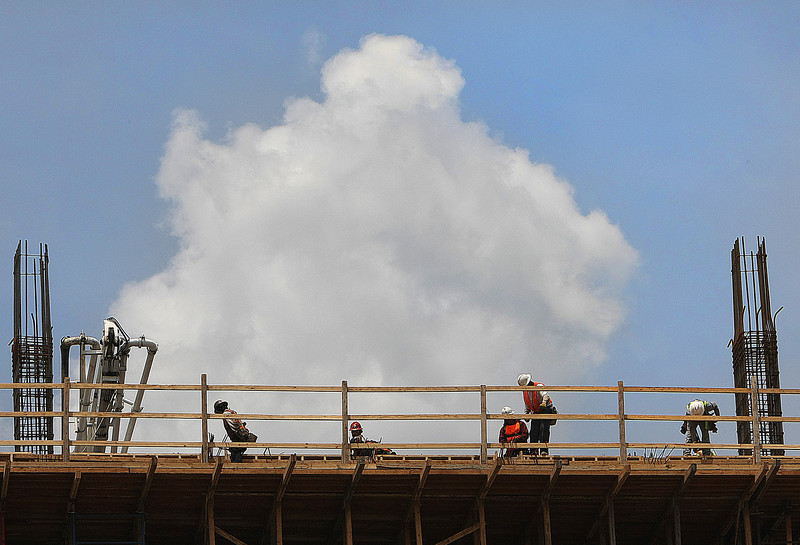 Workmen prepare cement forms while constructing the  One Place Tower in downtown Tulsa.