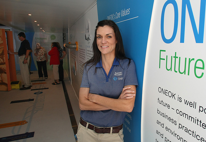 "Terri Pirtle, Executive Director of the OneOk Foundation, in the  ""Powered by ONE"" mobile exhibit in downtown Tulsa."