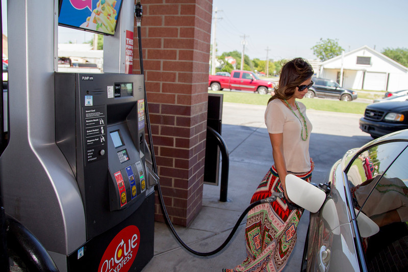 Lisa Laughlin pump ethonal blended gas at OnCue on 23rd Street and Broadway Extension.