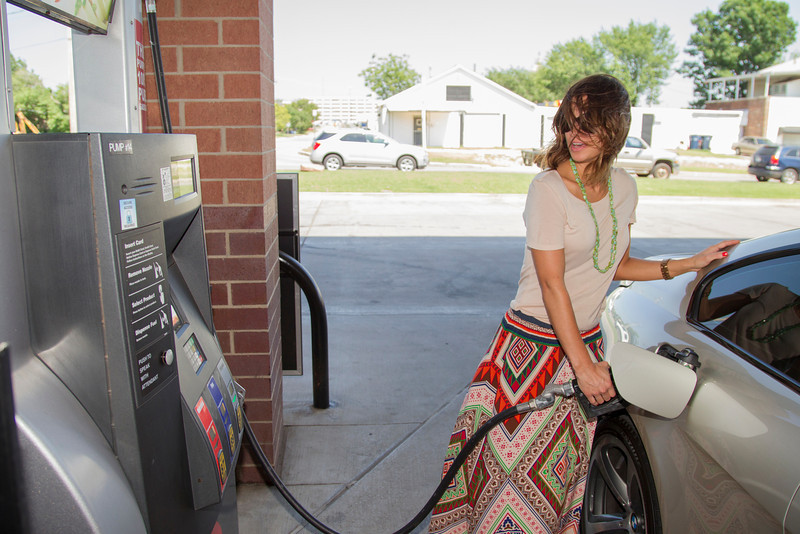 On a windy afternoon, Lisa Laughlin pumps ethonal blended gas at OnCue on 23rd Street and Broadway Extension.