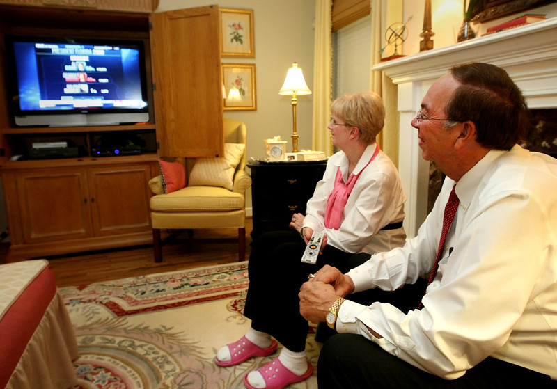 Carol and Jack Selby, owners of Bixby Funeral Home Service, watch election results.