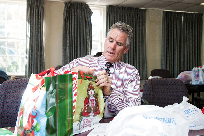 Captian Bo Mathews, with the Oklahoma City police, wraps gifts for needy children at Sunbeam Family Services.